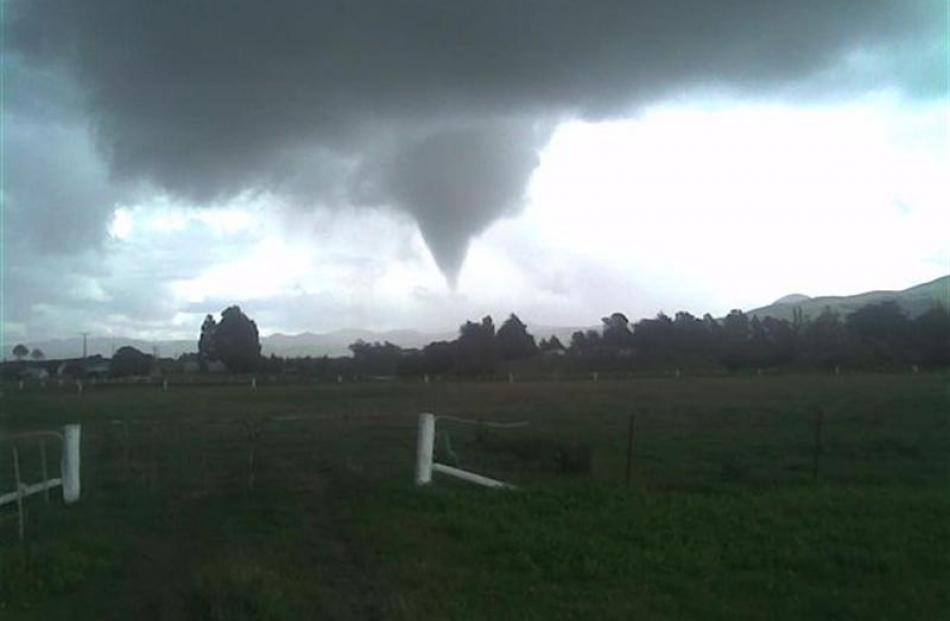 A tornado approaches the southern outskirts of Waikouaiti shortly after noon on Saturday. Photo...