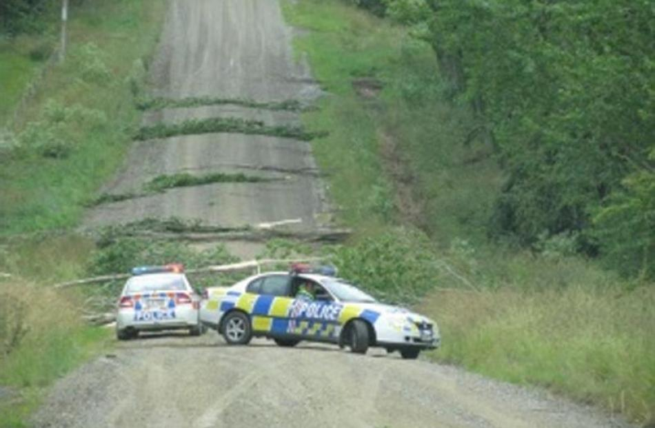 Police cars converge on a section of Ramrock Rd, about 2km south of Waikouaiti, after a tornado...