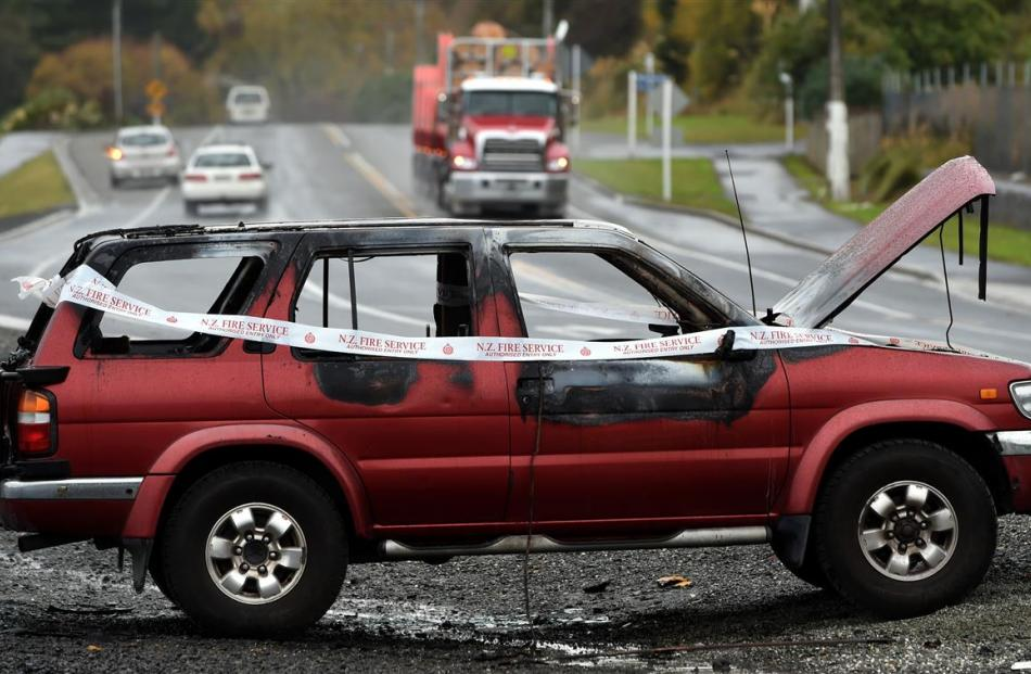 A burnt out vehicle near Sawyers Bay is the subject of an investigation by Dunedin police. PHOTO:...