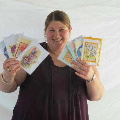 Nicole Broekhuyse, of Saddle Hill, creates Dutch-style paper tole 3-D gift cards.