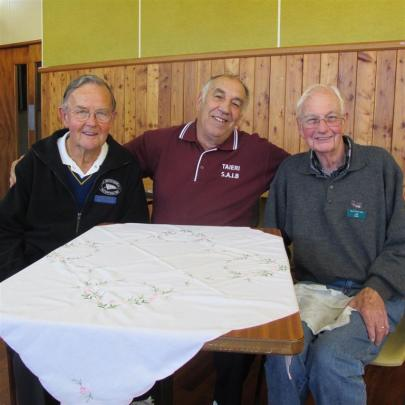 Tournament umpire Stan Rae (left), from the Mosgiel RSA, takes a breather with Taieri Sub...