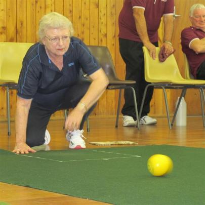 Town player Ann Cottrell, of Burnside, watches her bowl on its way down the green.