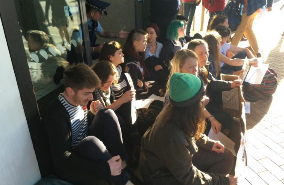 The protesters are lobbying the bank to divest itself of fossil fuel interests contributing to...