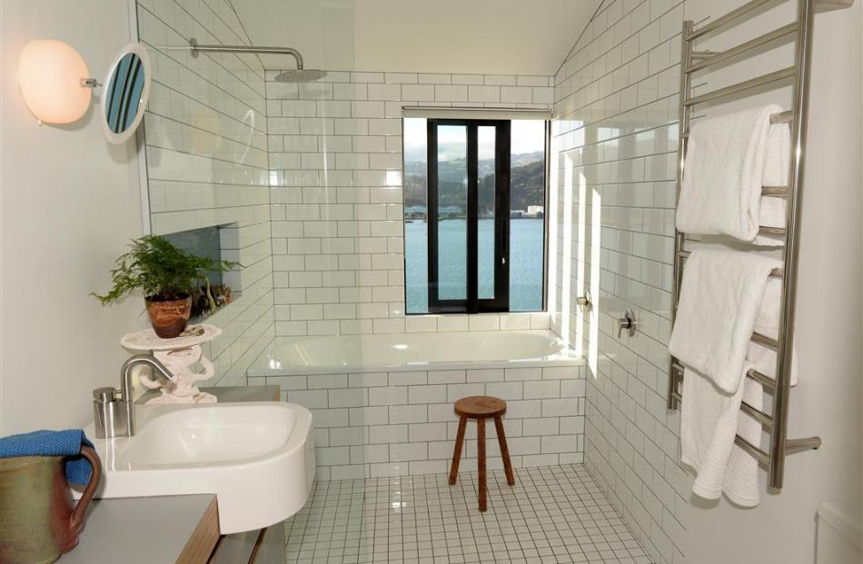 Being only one room wide, the house has water views from every area, including the bathroom.