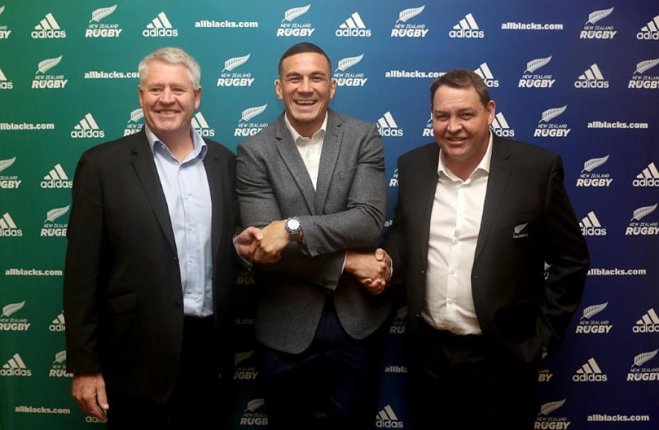 Sonny Bill Williams shakes hands with Steve Tew and Steve Hansen after signing with NZR and the...