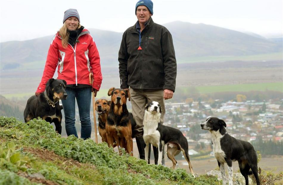 Steph and Roger Tweed with Grit, Gemma, Cooper, Price and Rose, above Omarama. Photo by Stephen...