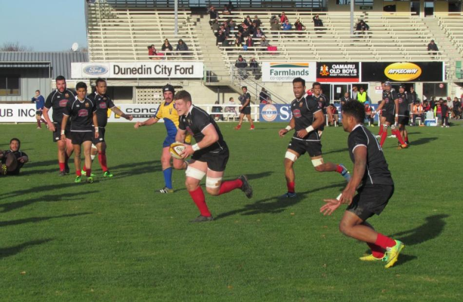 Old Boys on the attack against Valley at Whitestone Contracting Stadium in Oamaru today. PHOTO:...