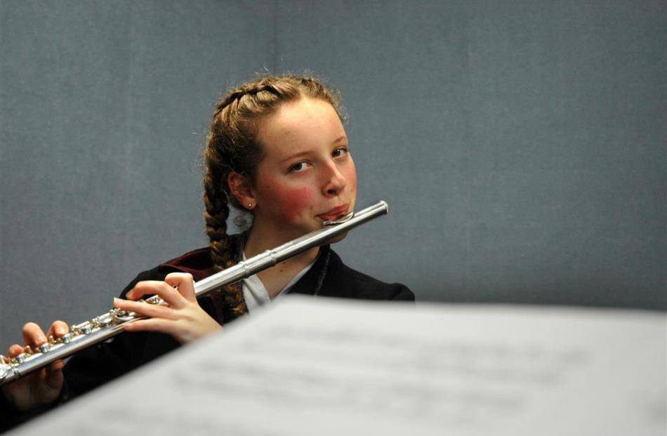 Grace Cunningham (Logan Park High School) works on her flute skills.