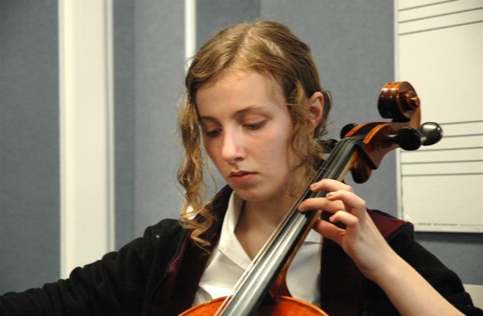 Rosa Miller is all concentration on the cello.