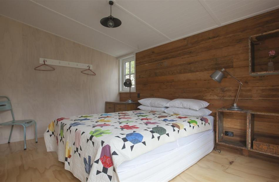 Rustic rimu sarking and bee box shelves feature in one of the bedrooms. Using peg rails rather...