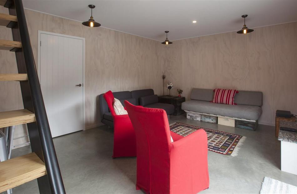 The second living area in the basement can be reached either from outside or by a steep internal...