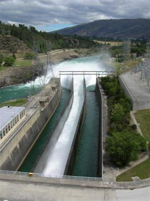 Water gushes from the Contact Energy's Roxburgh hydro dam on January 4, during a controlled...