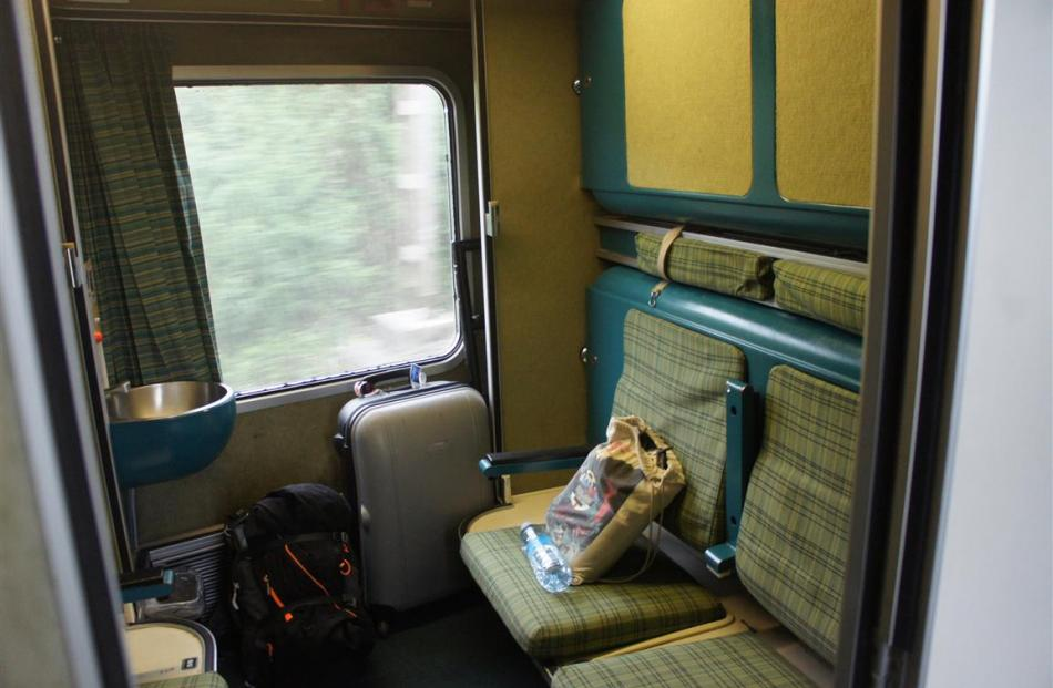 Seats turn to bunk beds after the conductor turns down the couchette cars on Renfe's Trenhotel.
