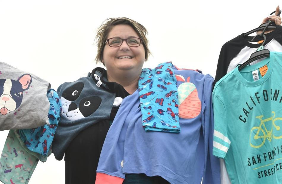 Foster Hope co-ordinator Juanita Willems holds a range of pyjamas donated  for foster children in...
