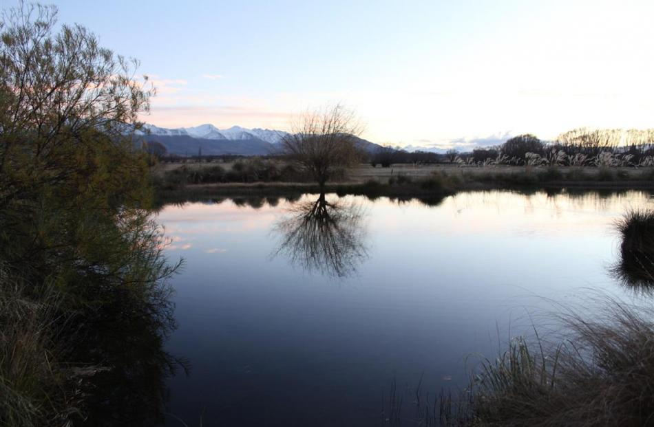 Matuka Lodge in Twizel looks out over a river-fed pond and on towards the Southern Alps.