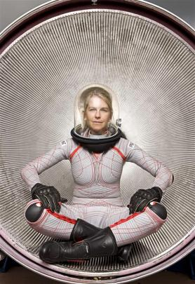 Dr Dava Newman shows a new generation space suit she helped develop. Photo by Douglas Sonders.