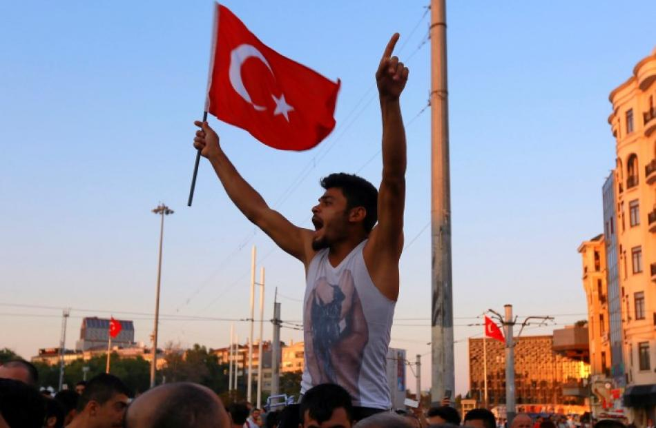 A man waves a Turkish flag at Taksim Square in Istanbul. Photo Reuters