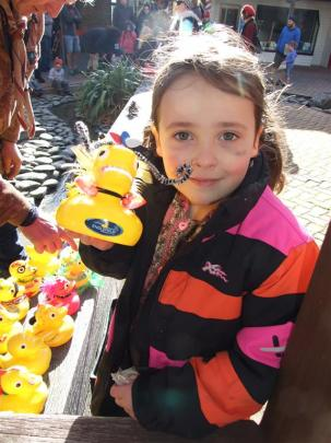Mischa Thomlinson (6), of Cromwell, proudly displays her decorated duck. Photos by Lynda van Kempen.
