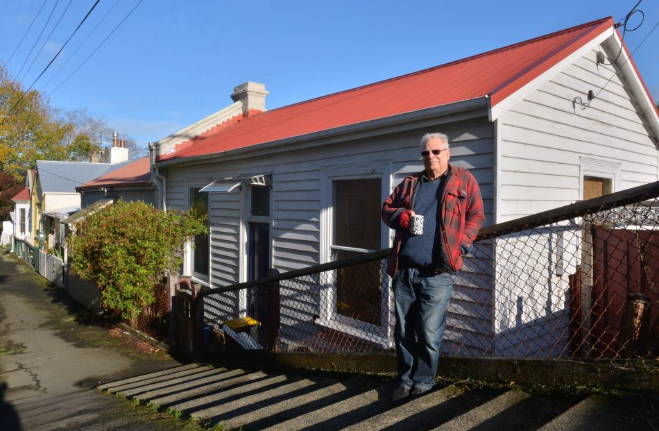 Historic cottages . . . Jack Austin,  of Port Chalmers,  who  is seeking council recognition for...