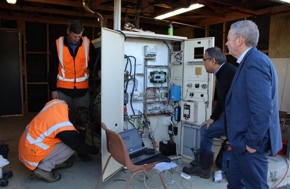 Inspecting the generator converting dairy effluent methane into electricity on a Southland dairy...