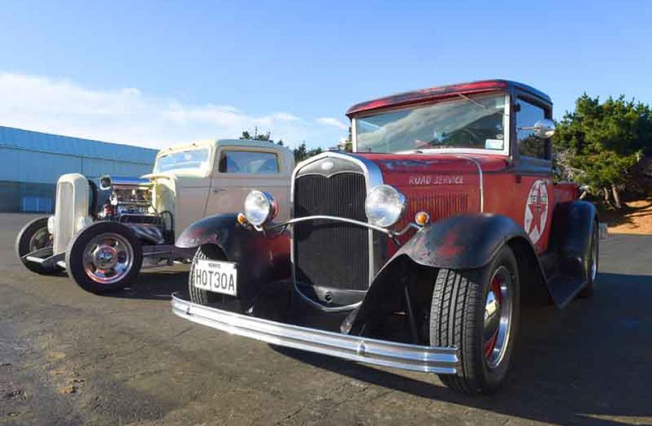 A 1930 Model A (foreground) and a 1932 Deuce Coupe.
