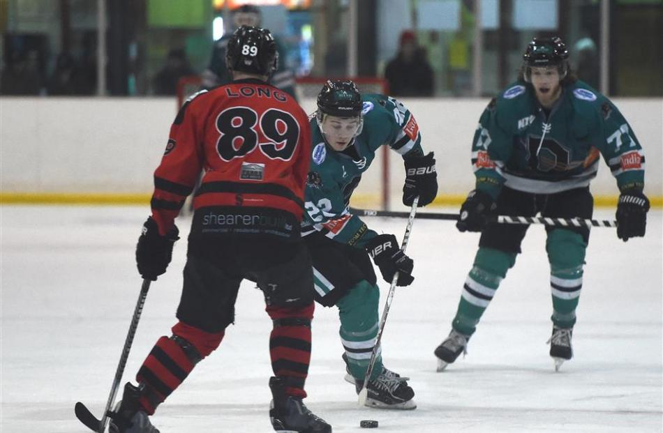 Shaun Harrison, of the Dunedin Thunder, looks to beat Ciaran Long, of the Canterbury Red Devils,...
