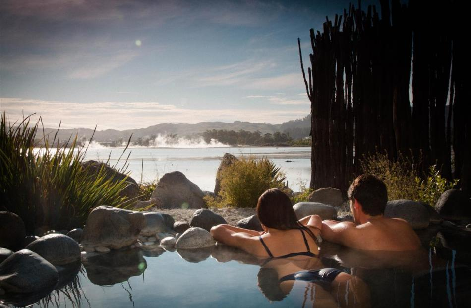 A couple relaxes in natural hot springs at the Polynesian Spa, Rotorua. PHOTO: SUPPLIED