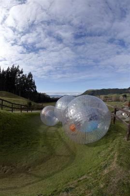 Plastic orbs roll down a windy track at Zorb Rotorua. PHOTO: SUPPLIED