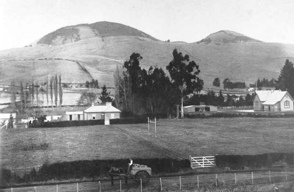 Saddle Hill viewed from East Taieri in 1908. Otago Witness photo.