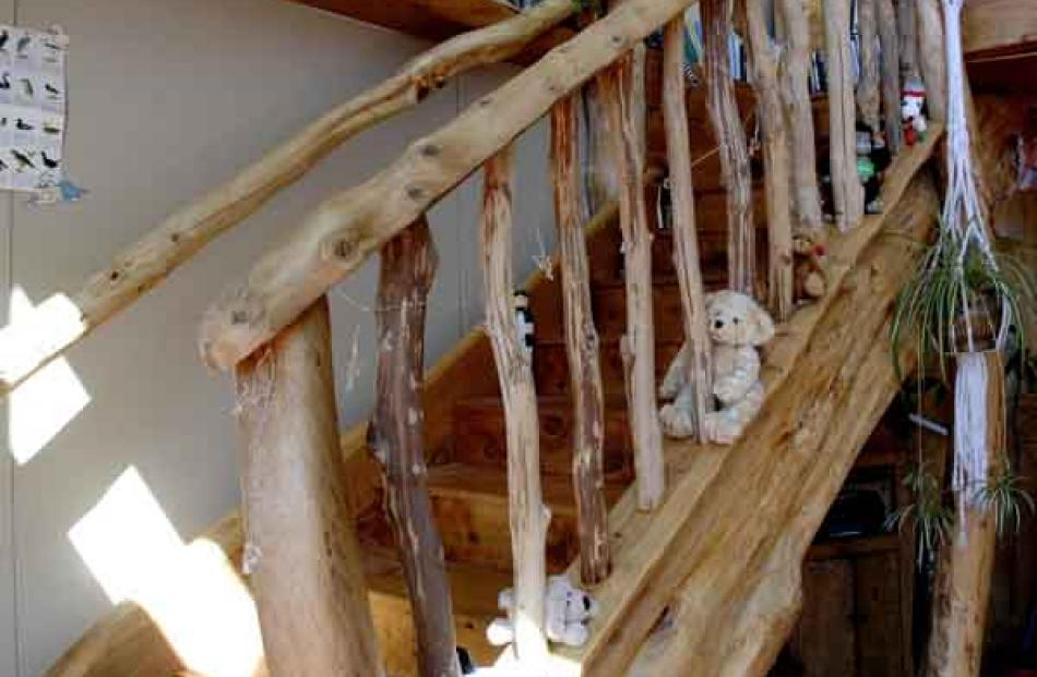 The staircase is made out of discarded timber offcuts and trees from their own forest.