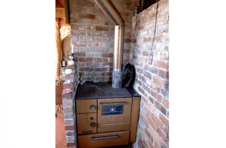 The Wamsler wood stove has a wetback to heat the hot water.
