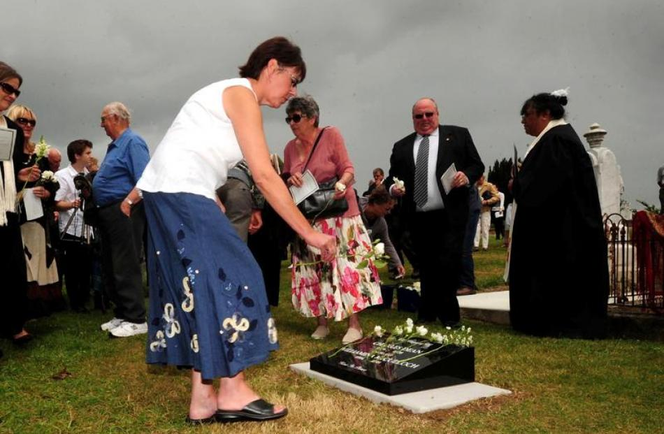 Paula Wells, a descendent of Minnie Dean, lays flowers on the grave.