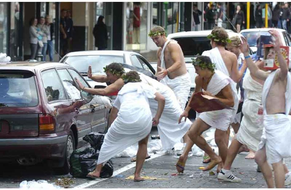 Toga wearers remonstrate with occupants of a car in George Street.