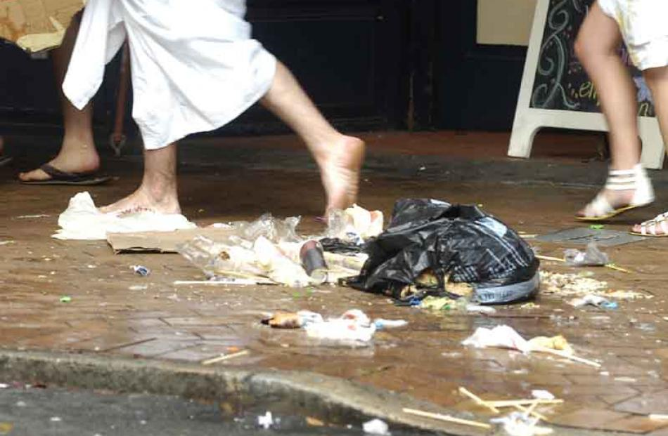 Toga wearers head home through detritus.