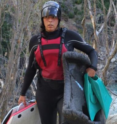 A member of the Mad Dog River Boarding trip emerges from the river.