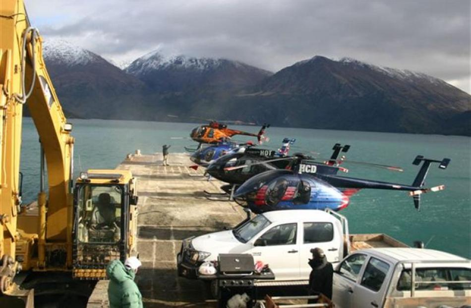 Vehicles of all descriptions line up on the Minaret station barge during the weekend attempt to...