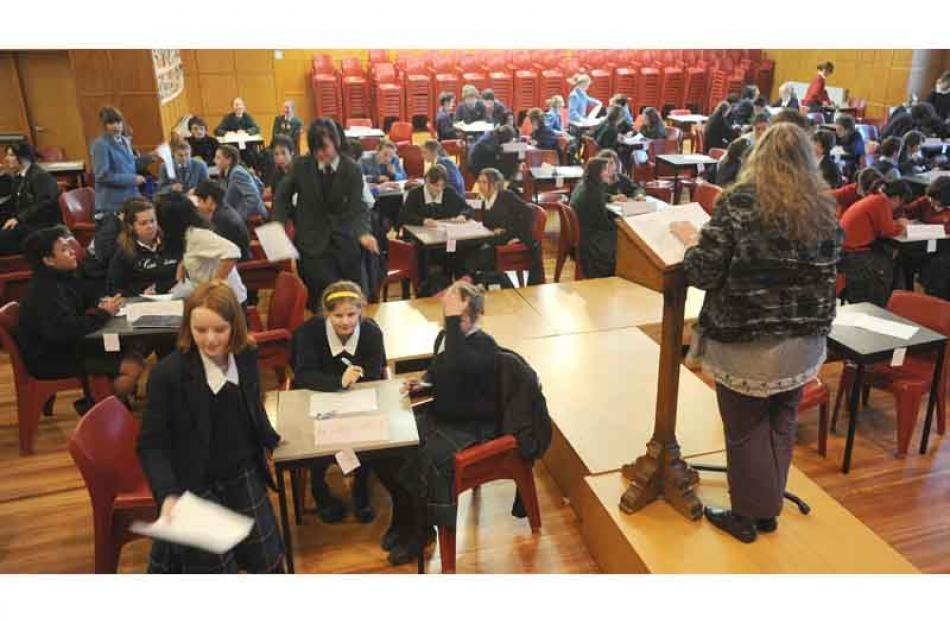 Year 9 and 10 pupils listen as a question is given.