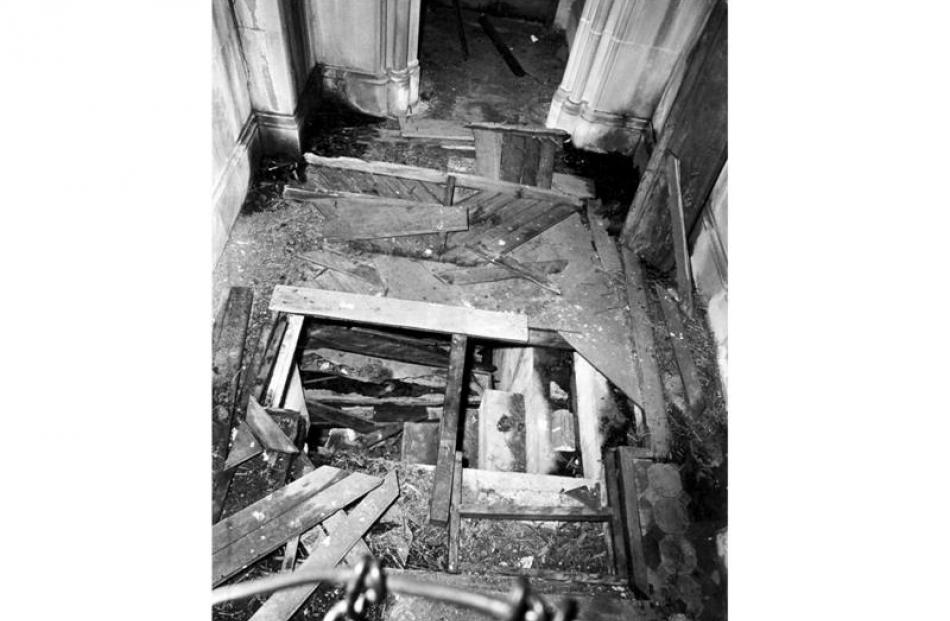 A 1972 photograph showing the desecration: the remains of the original herringbone-patterned...