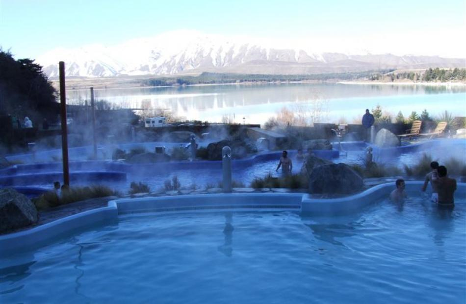 The Alpine Springs hot pools are shaped in the configuration of the local glacier lakes, with...