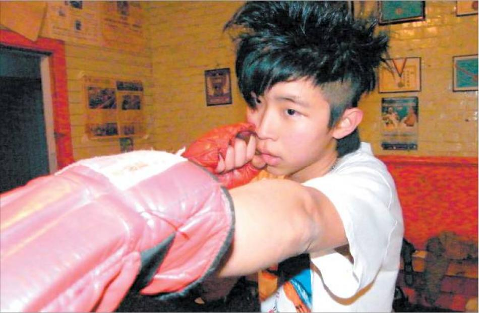 Straight left: Malaysian student Yeow Lim (16) finds focus at the Gore Boxing Club.