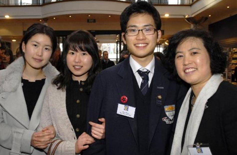 Otago Boys High School pupil and Class Act Award recipient Juno Pyun (centre right) with his...