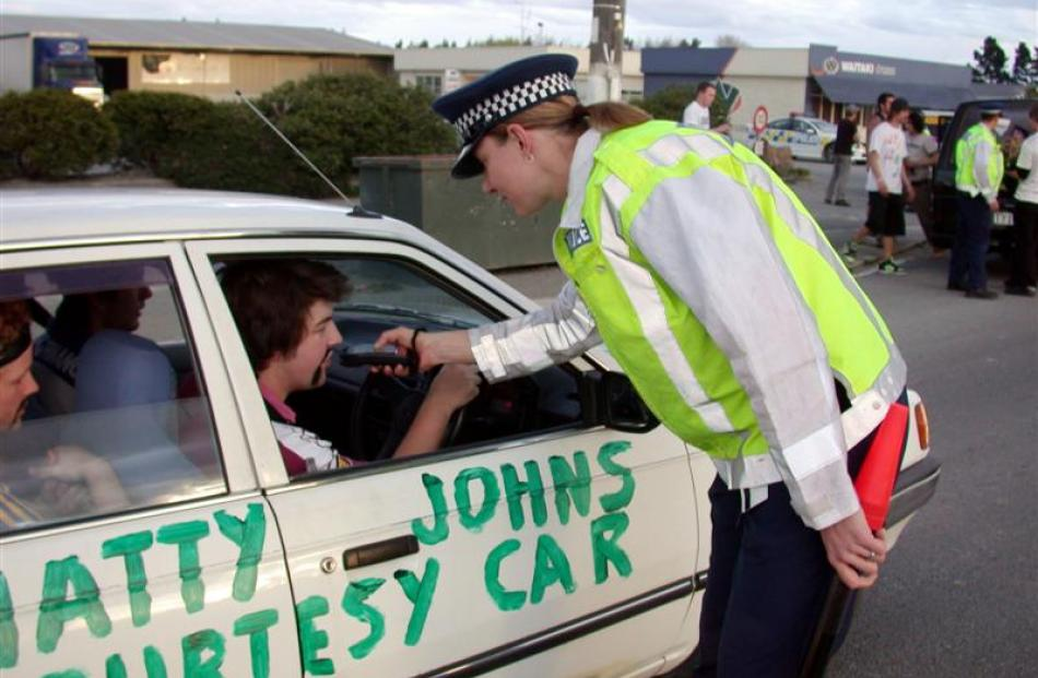 Constable Delaine Patterson, of Alexandra, does a preliminary breath test on the driver of one of...