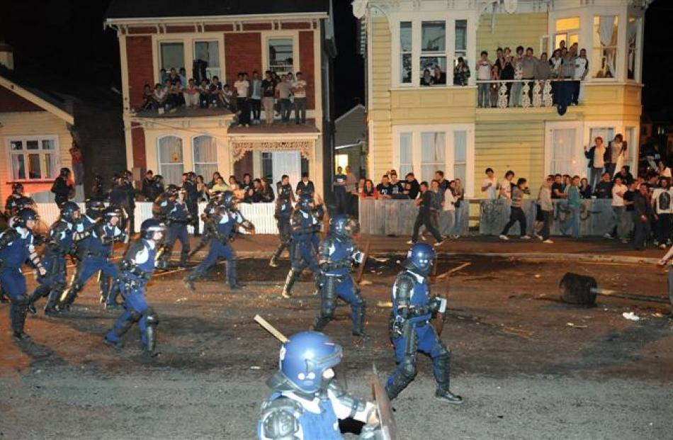Police in riot gear advance on the crowd about 1.20am. Photos by Stephen Jaquiery.