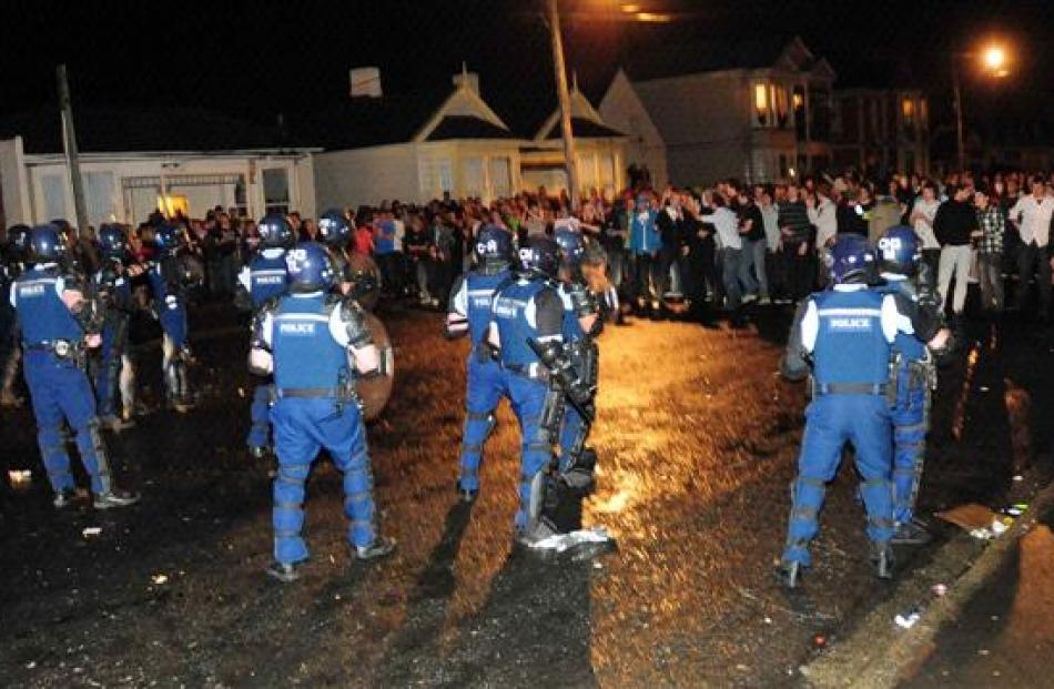 Police in riot gear move in. Photo by Craig Baxter