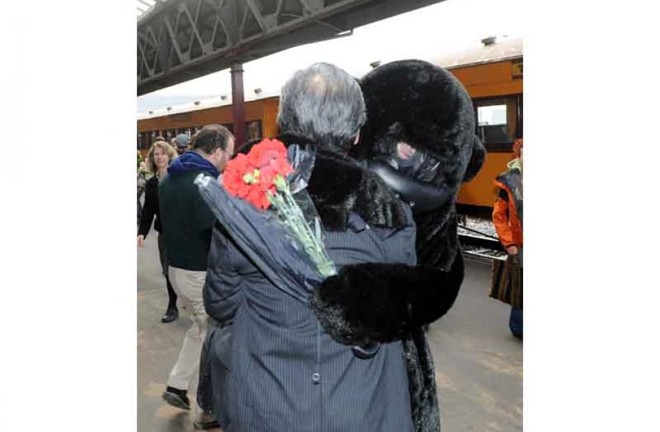 Mr Chin hugged by Chris Skellett of Warrington.