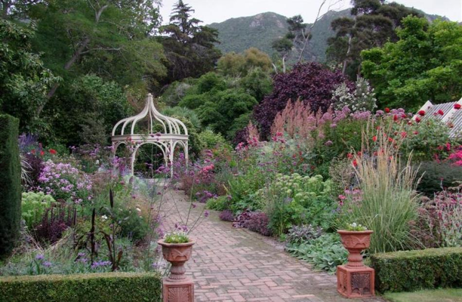 The wide herbaceous border at Ohinetahi is packed with plants in complementing colours and...