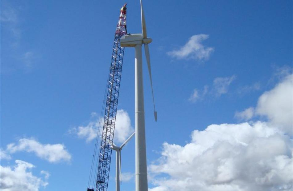 A crane works on the 45m tall wind towers. Photos supplied.