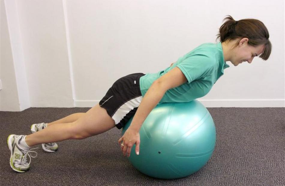 Lying on your front over a Swiss ball, slowly raise your upper body to a point below 90deg and...