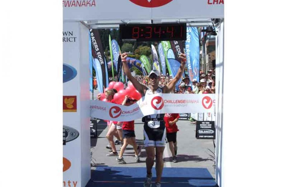 Richard Ussher crosses the finish line to win the Challenge Wanaka at his first attempt, setting...