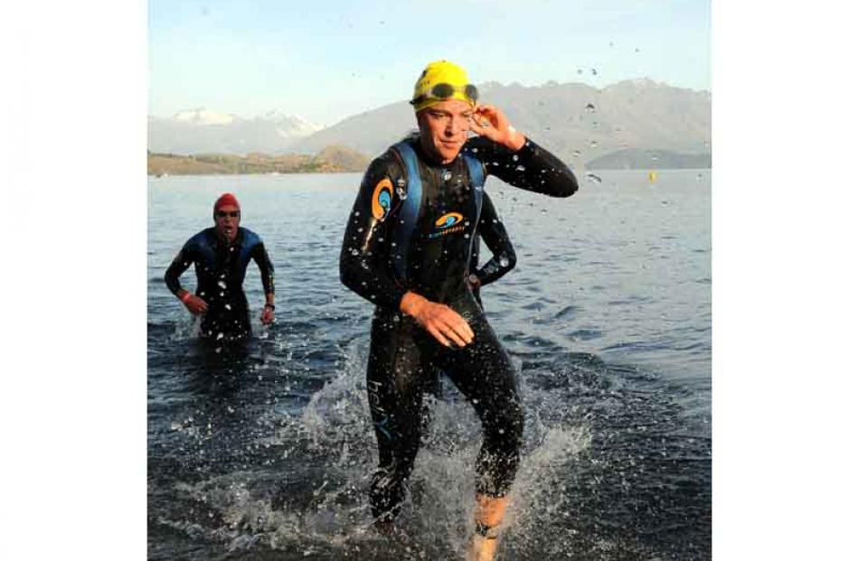 Individual womans ironman winner Gina Crawford leaves the water after her 3.8km swim in a time of...